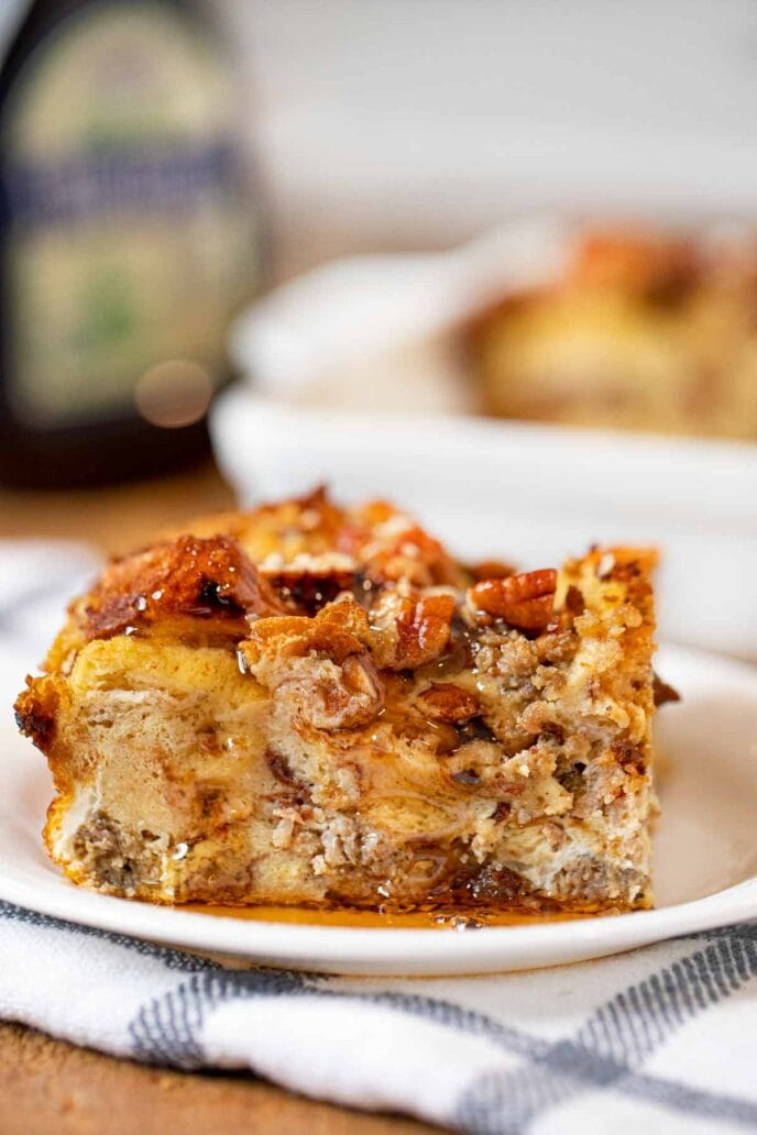 Cinnamon Raisin Sausage Breakfast Bake serving on plate with maple syrup