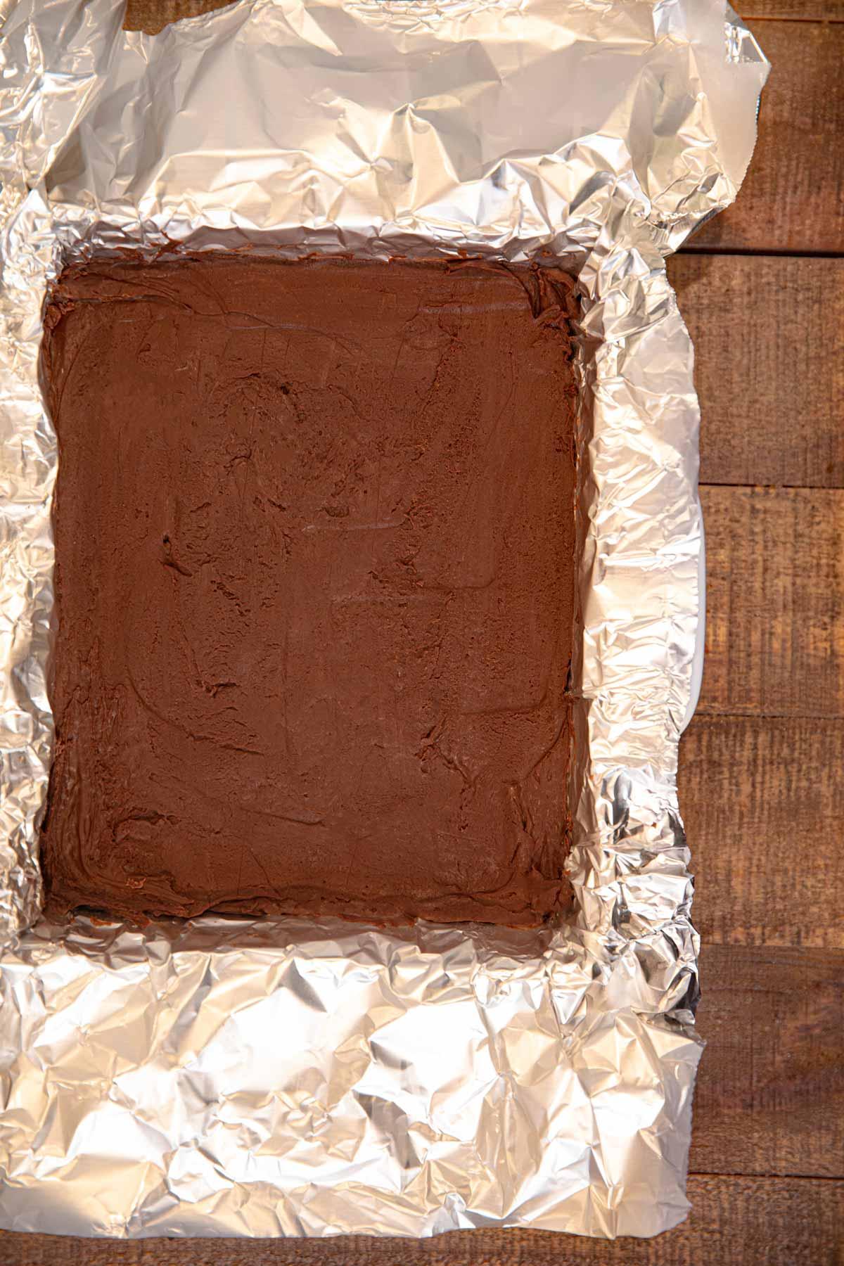 Dark Chocolate Orange Fudge in baking pan with foil