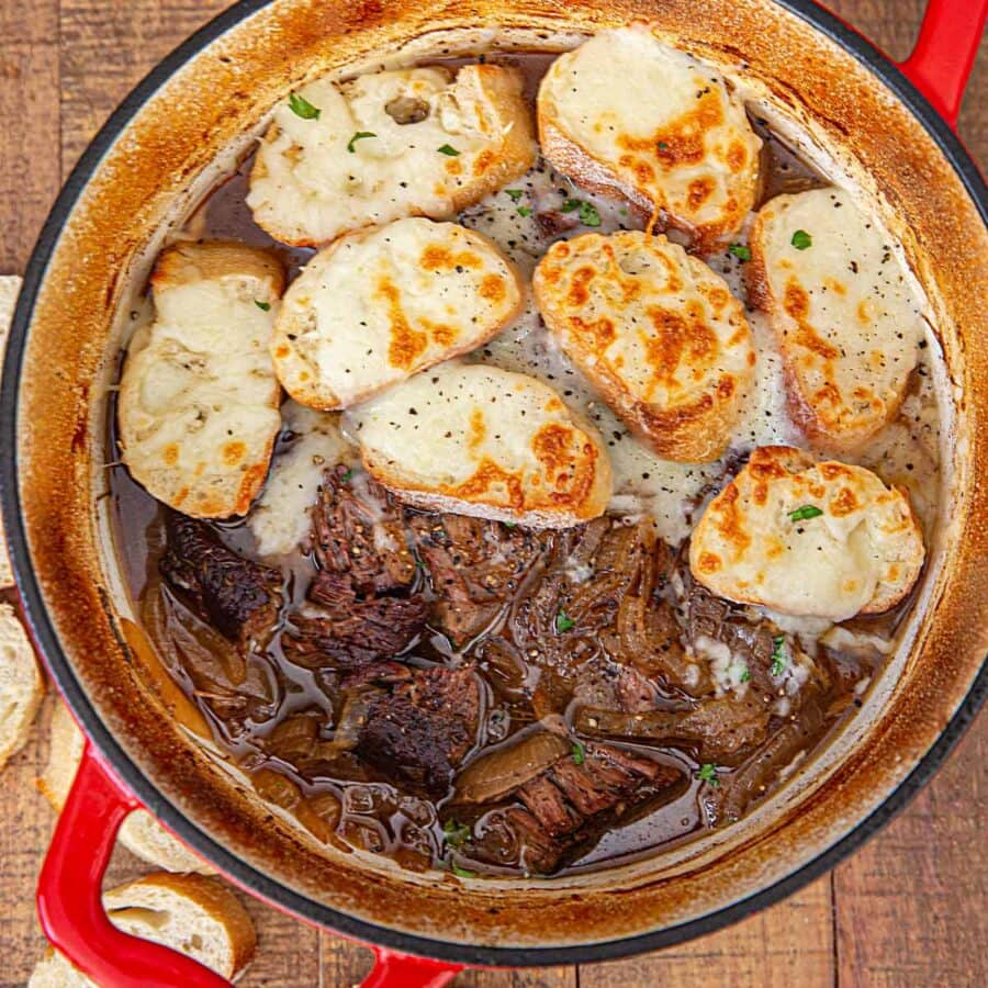 Cropped French Onion Pot Roast with Croutons and cheese in red pot