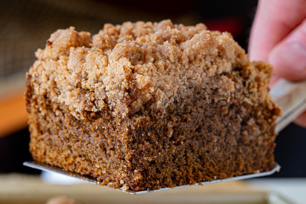 Gingerbread Crumb Cake slice on spatula