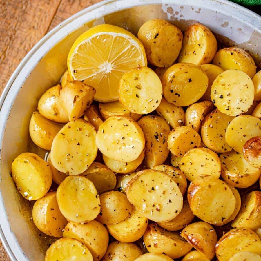 Greek Lemon Potatoes in pie plate with lemon