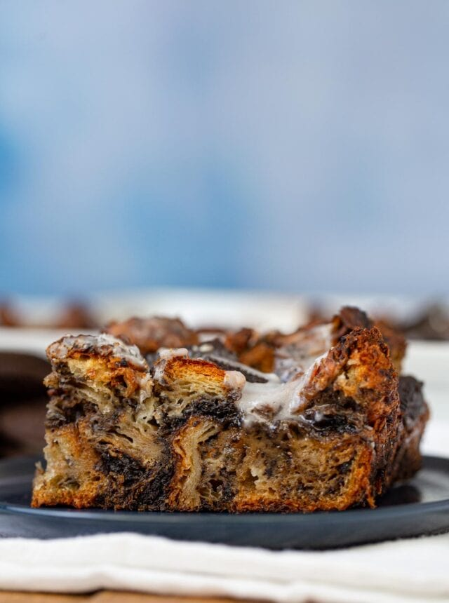 Oreo Croissant Bread Pudding on plate with blue background