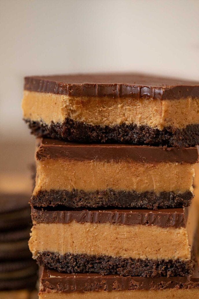 Bite of Peanut Butter Oreo Bars in a stack