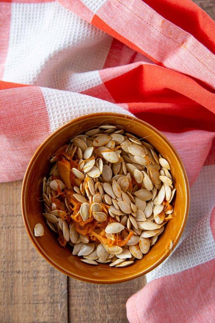Roasted Pumpkin Seeds raw seeds in bowl