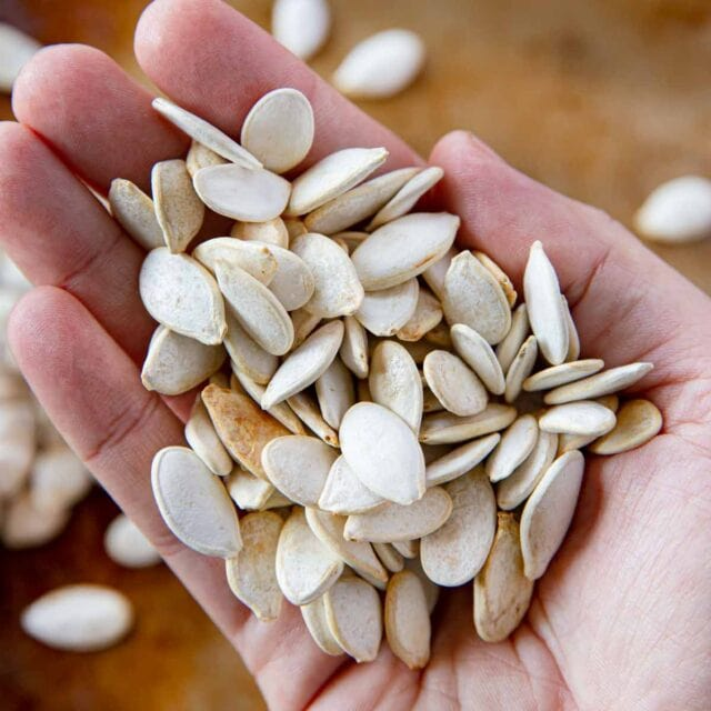 Roasted Pumpkin Seeds held in hand