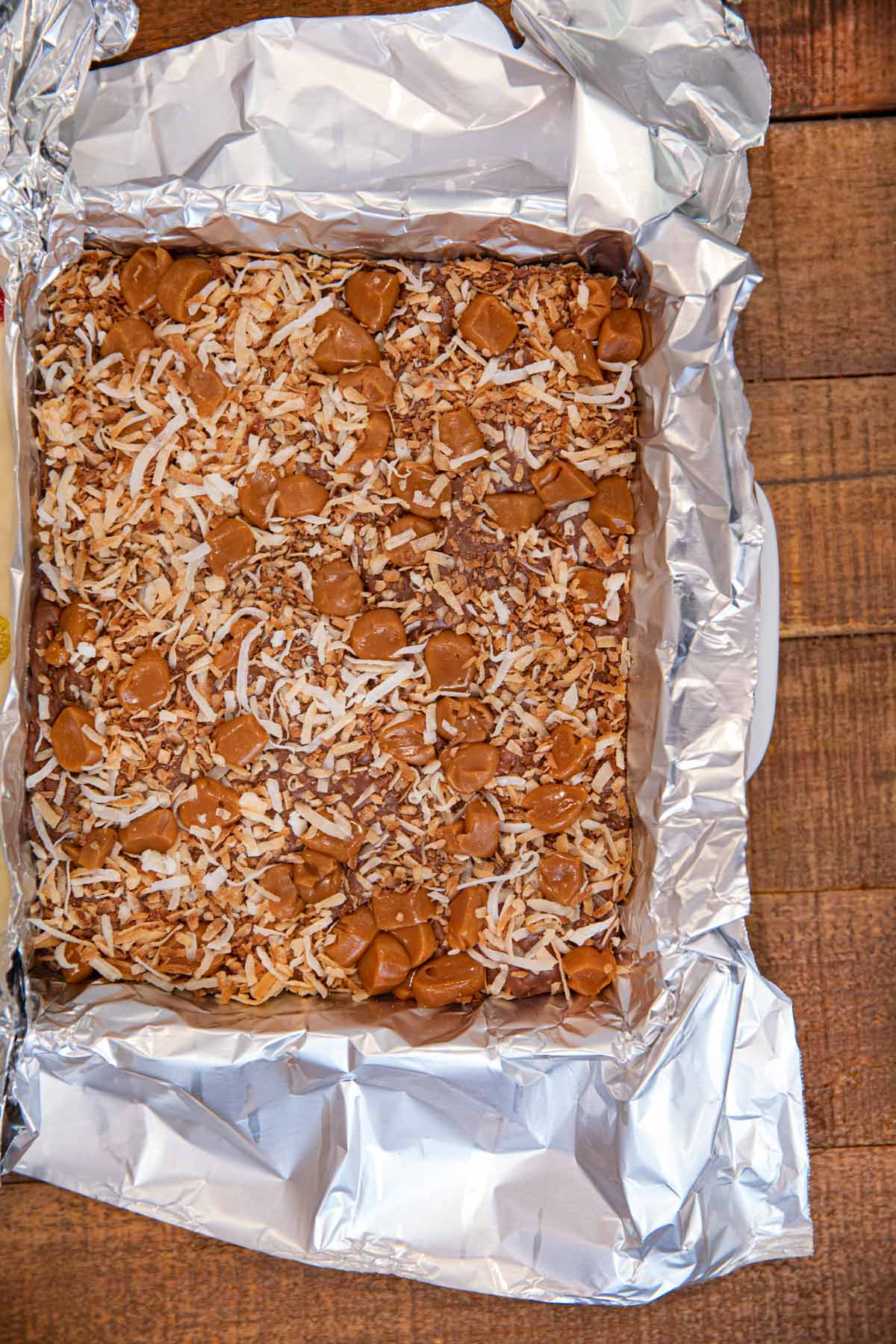 baking dish of Samoa's Cookie Fudge lined with foil