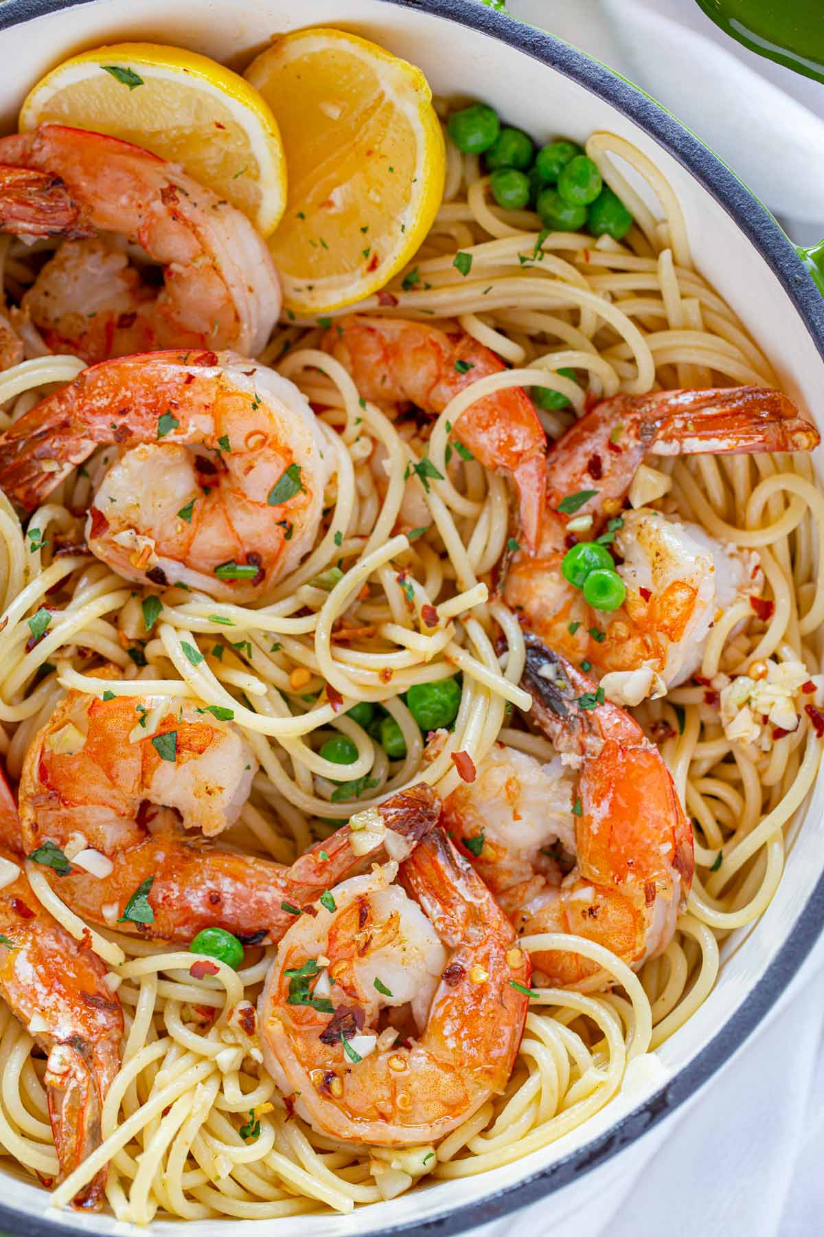 Shrimp Scampi Pasta with lemon and peas in large green pot