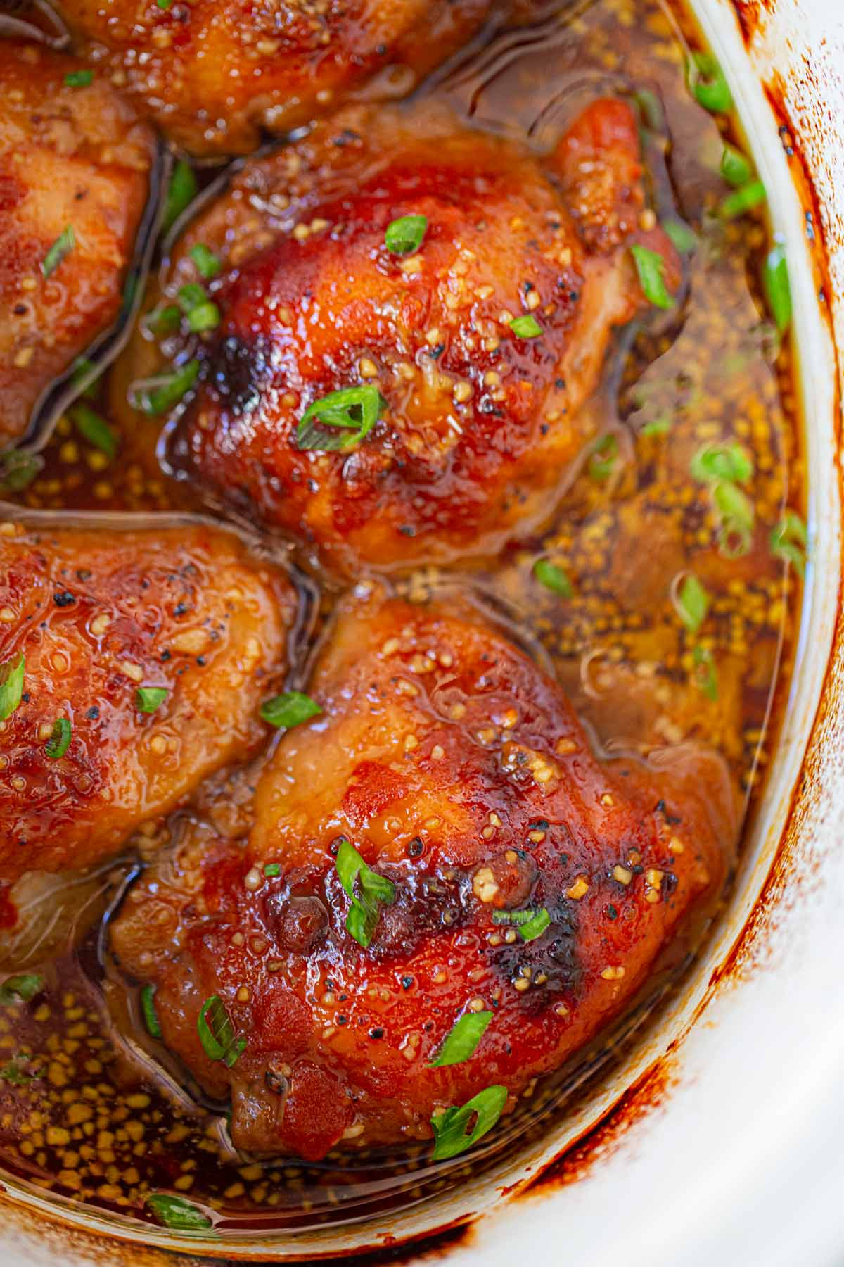 Slow Cooker Brown Sugar Sriracha Chicken topped with green onions