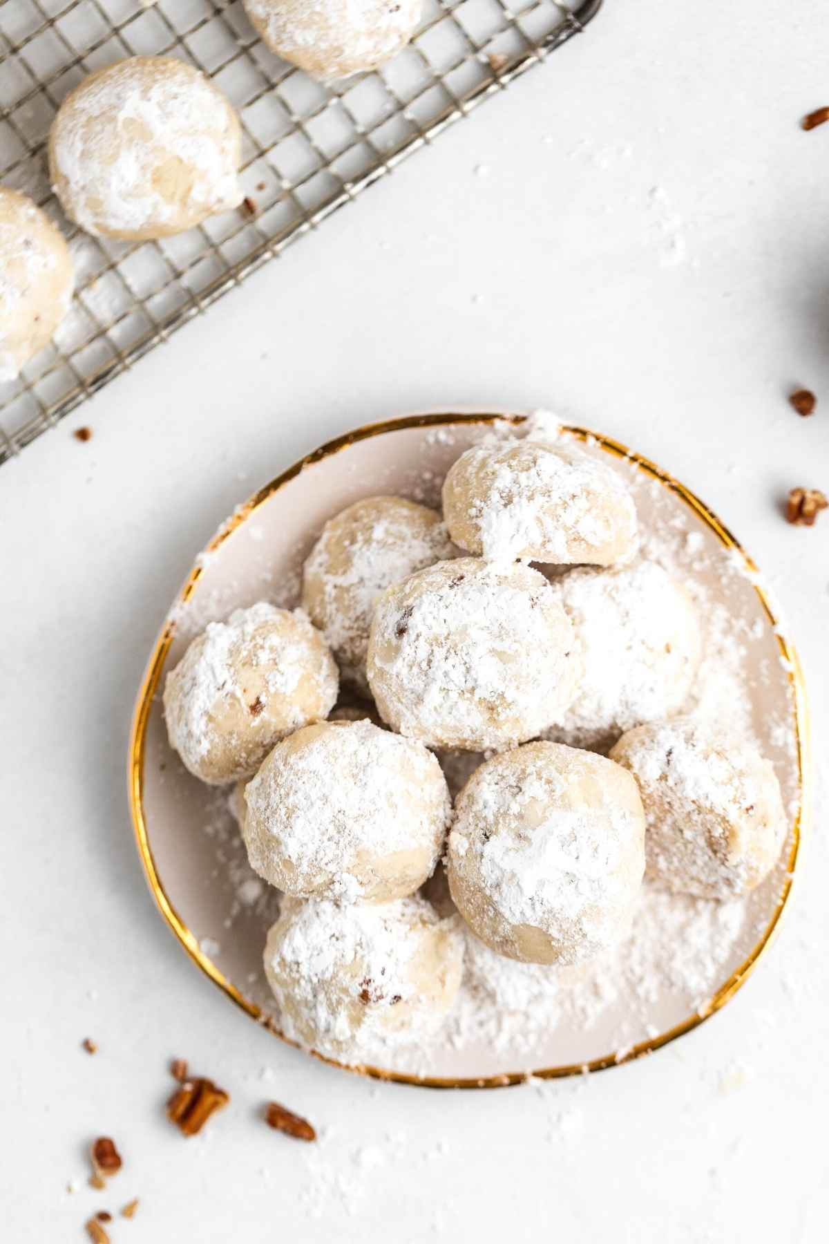 Snowball Cookies on serving plate with bite taken
