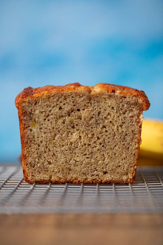 Sour Cream Banana Bread loaf cross-section on cooling rack