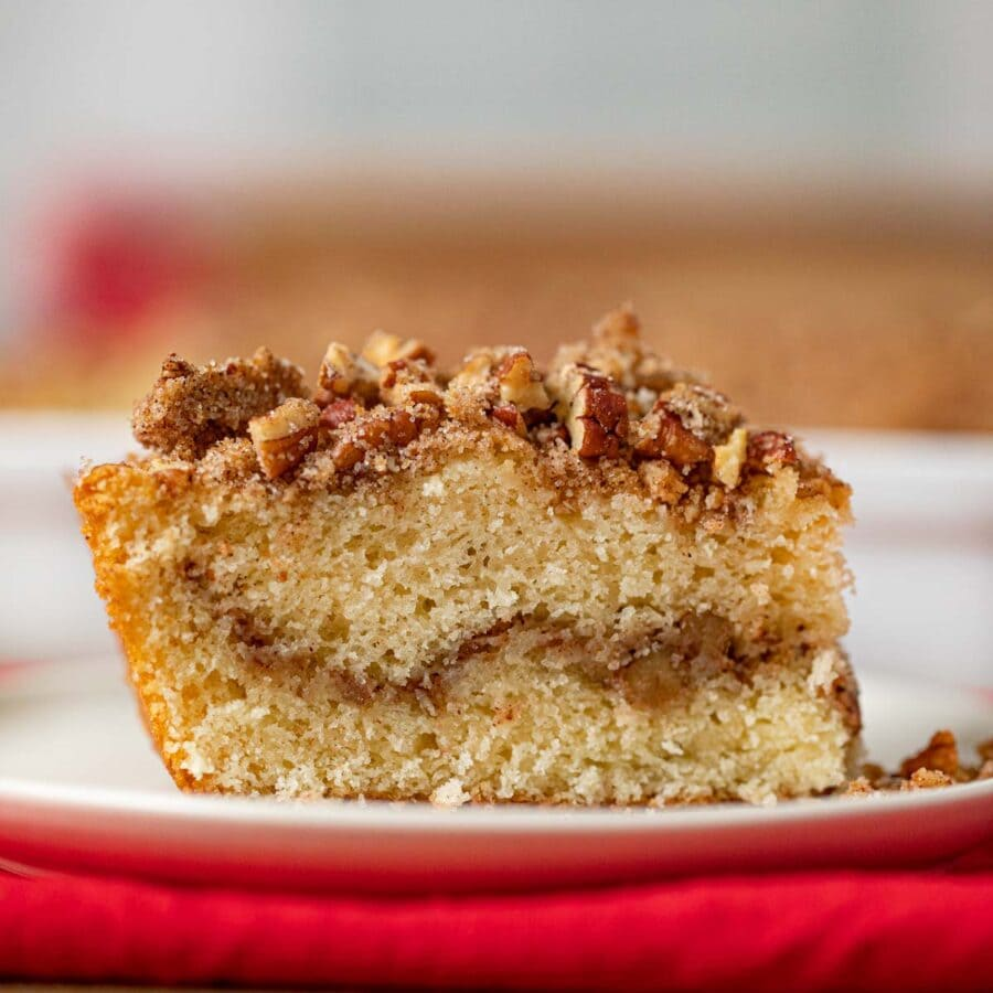 Sour Cream Coffee Cake cropped on white plate and red napkin