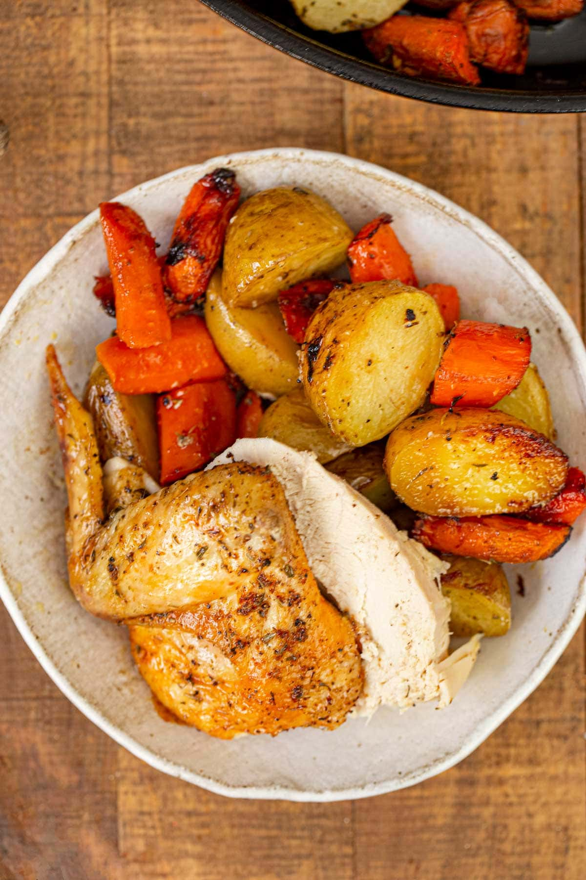 Beer Can Chicken served in bowl with vegetables