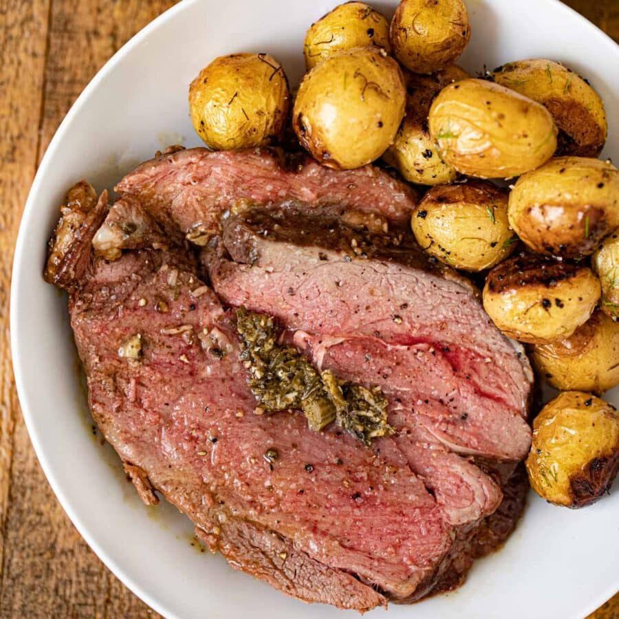Stuffed Leg of Lamb with pesto in bowl