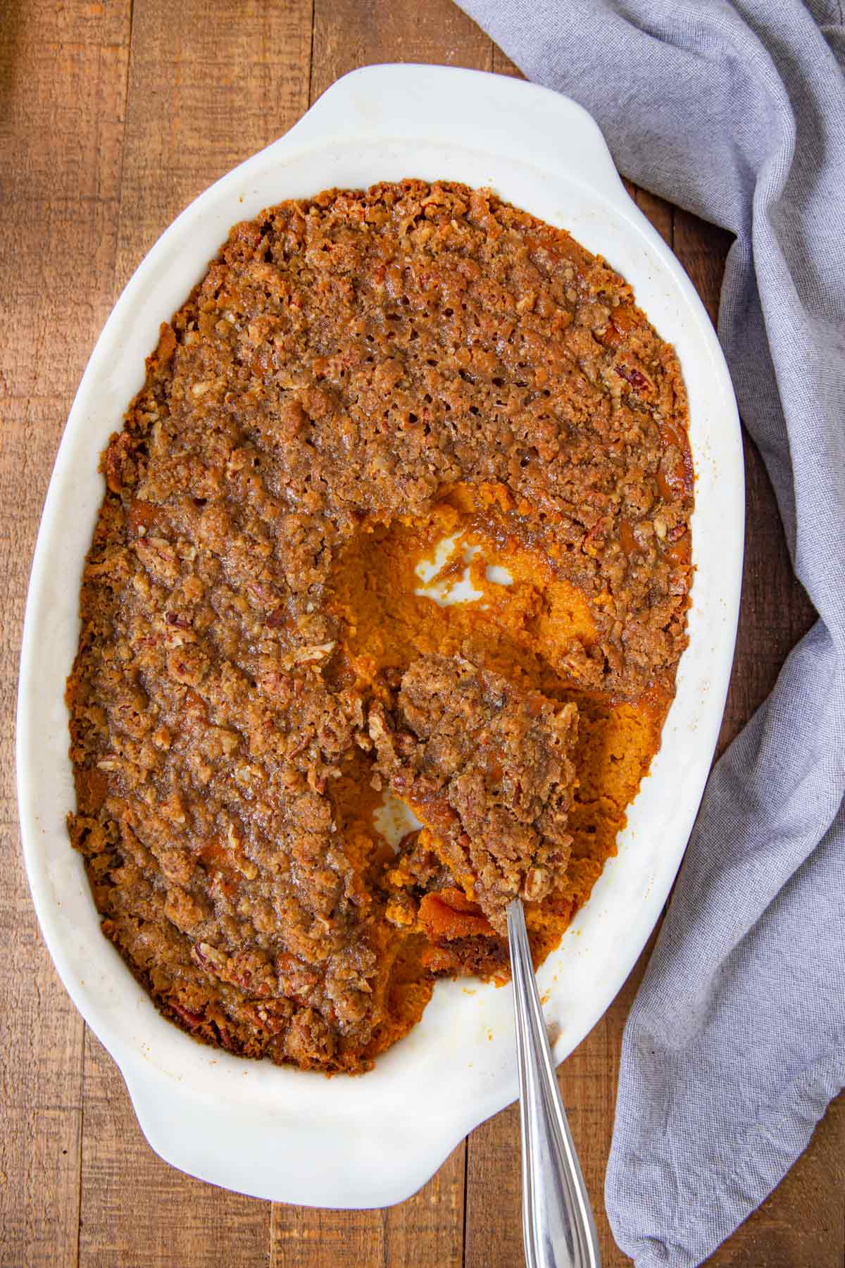 Sweet Potato Soufflé with spoonful scooped out of baking dish