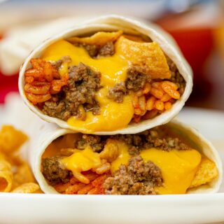 Taco Bell Beefy Fritos Burrito on plate with Fritos