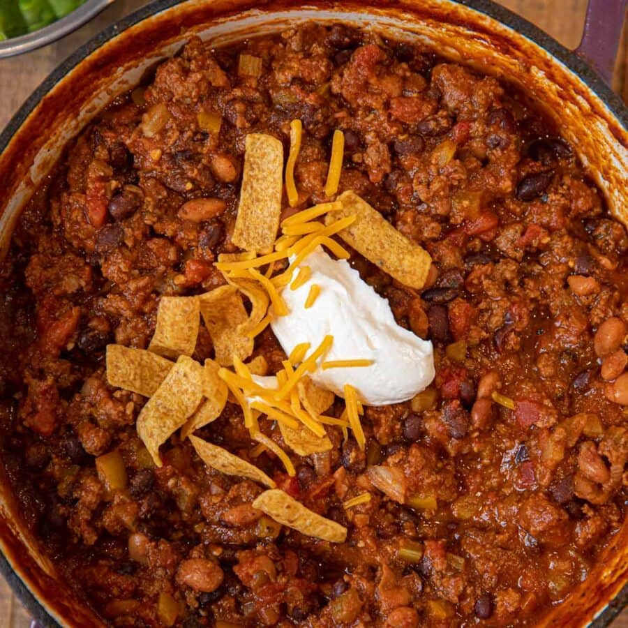 Taco Chili garnished with sour cream, cheese and Fritos