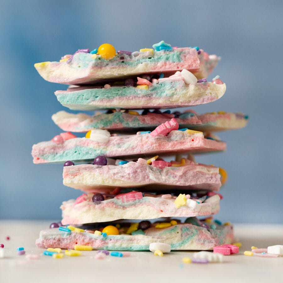 Unicorn Bark in a stack with sprinkles and a blue background