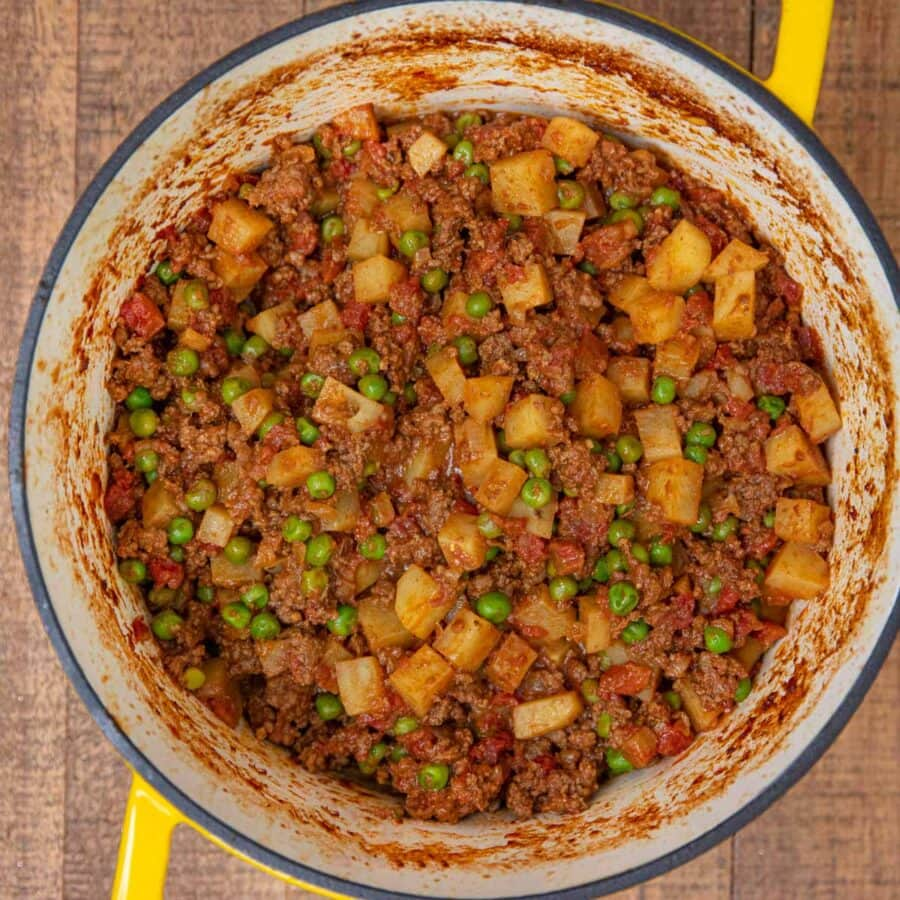 Indian Keema Aloo Beef and Potatoes in yellow pot up close