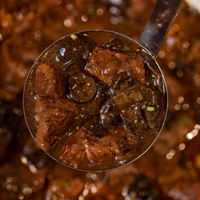 Beef and Mushroom Stew in ladle