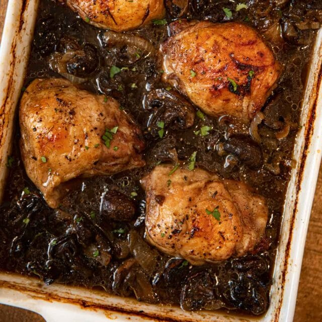Beer Braised Chicken Thighs in baking dish