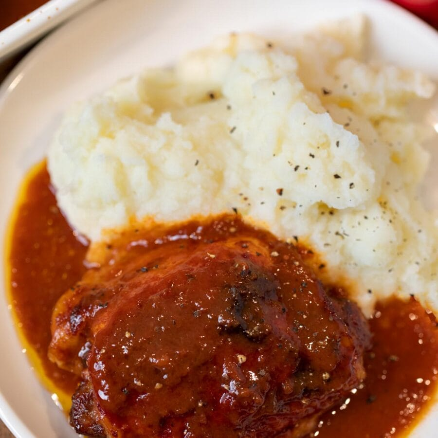 Coca-Cola Chicken in bowl with mashed potatoes