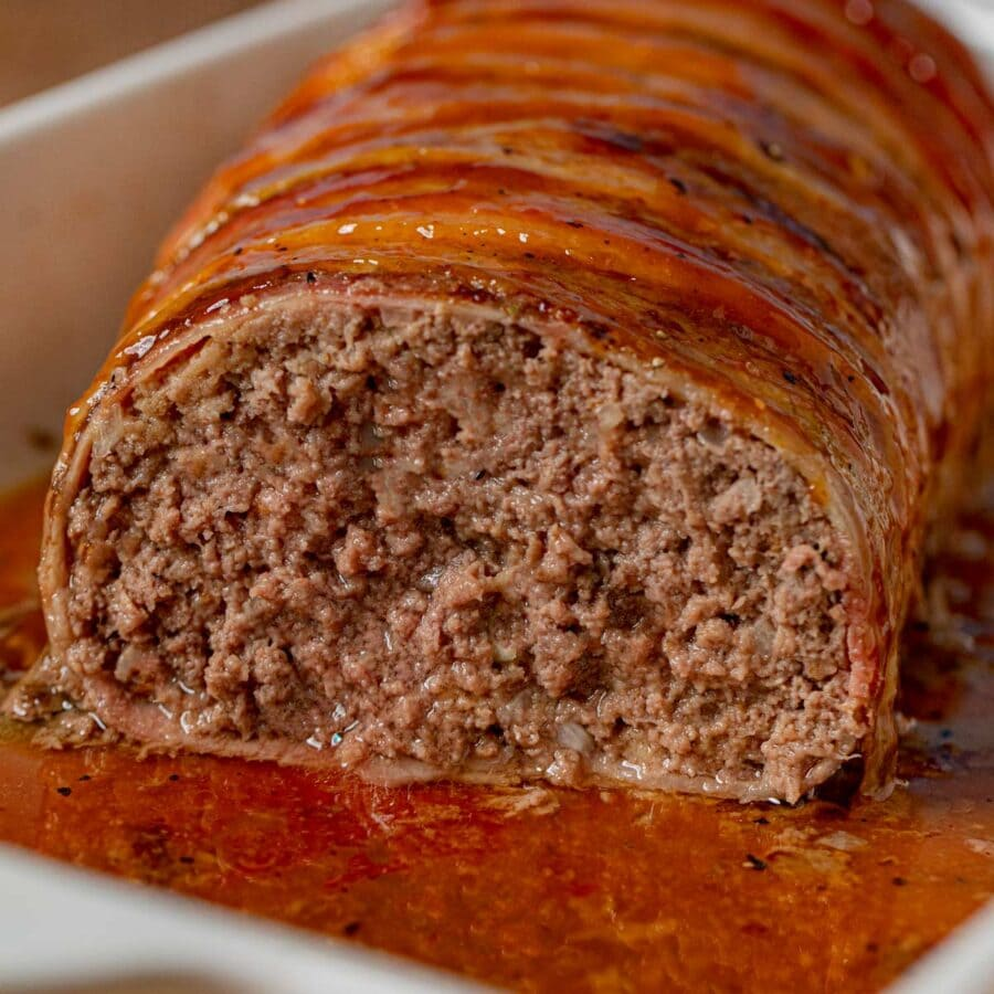 Bacon-Wrapped Meatloaf cross-section in baking dish