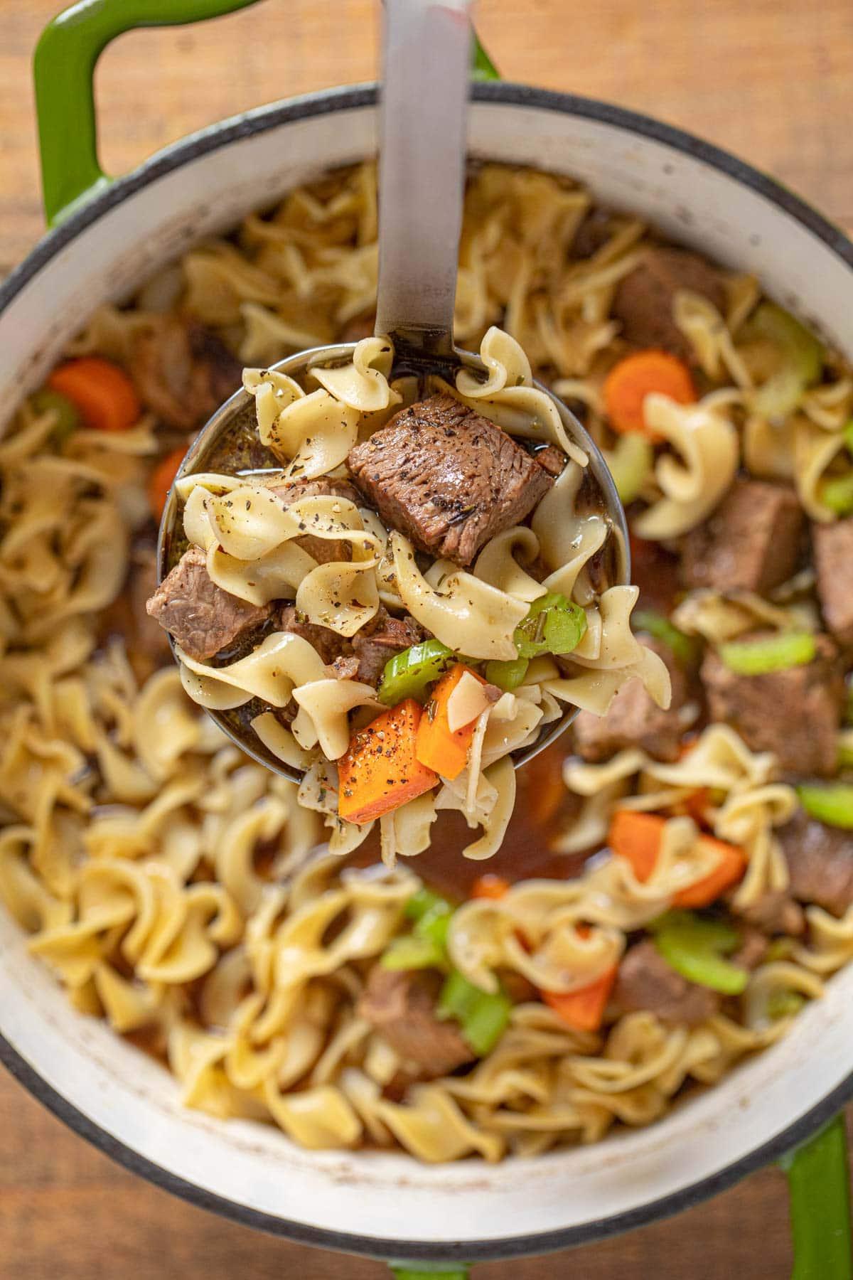 Beef Noodle Soup serving in ladle
