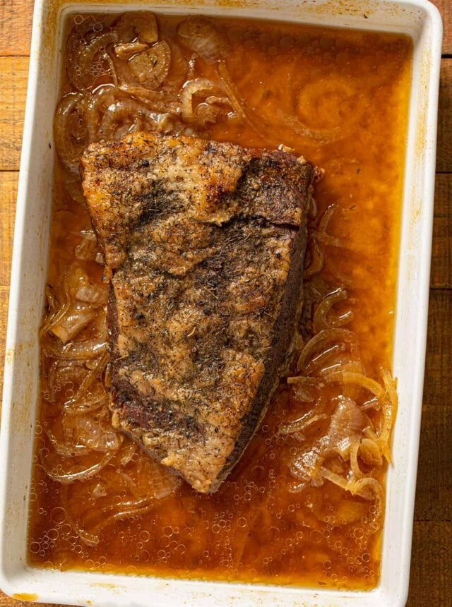 Beer and Onion Brisket in baking pan
