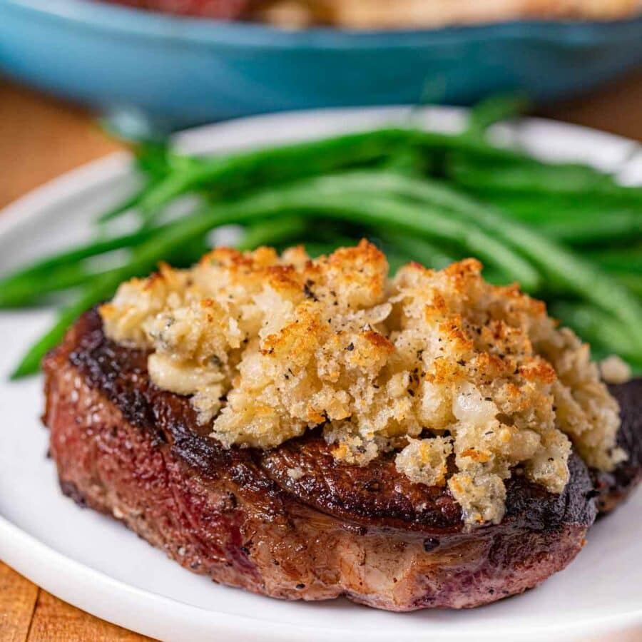 Blue Cheese Crusted Filet Mignon on plate with green beans