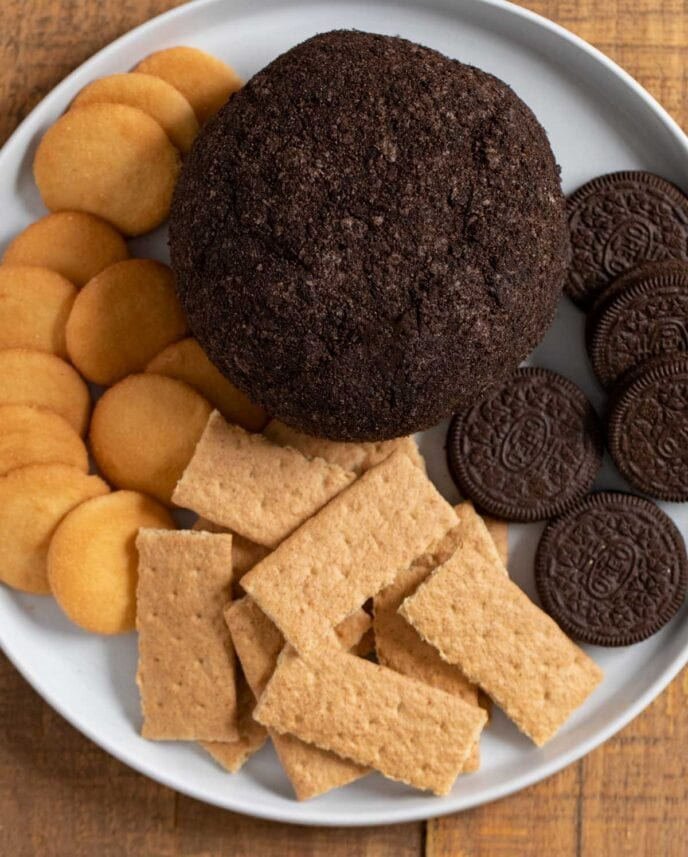 Chocolate Oreo Cheese Ball on plate with cookies