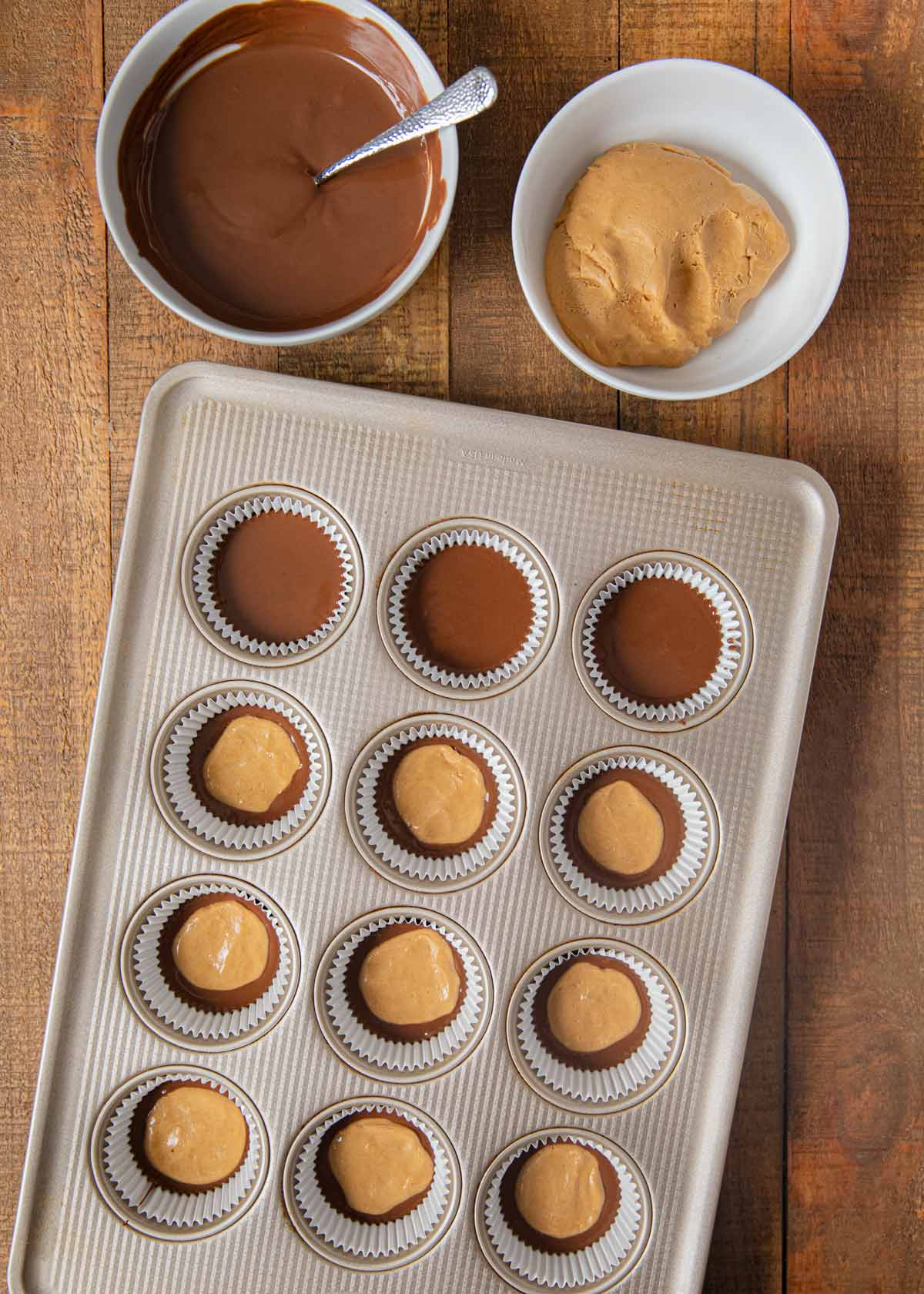 Chocolate Peanut Butter Cups chocolate and peanut butter in cupcake tin