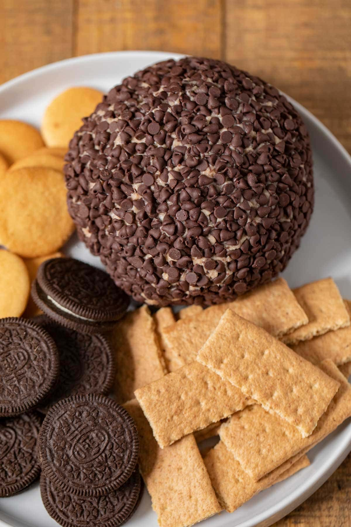 Cookie Dough Cheese Ball on plate with assorted cookies