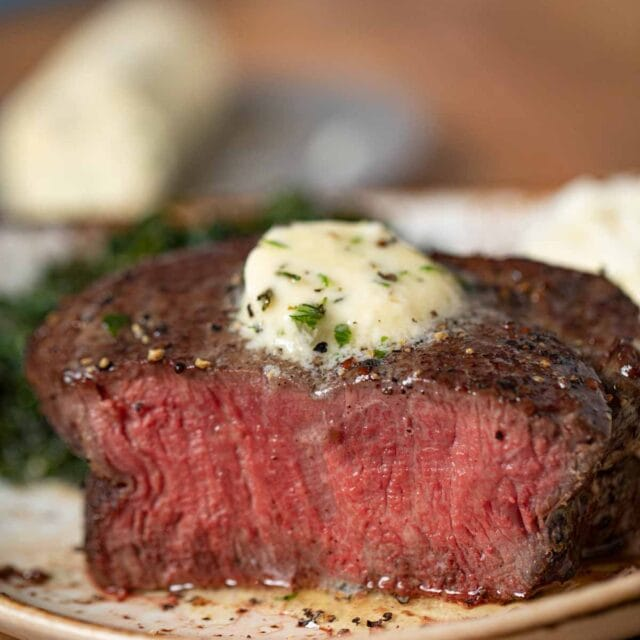 Filet Mignon on plate with garlic herb butter