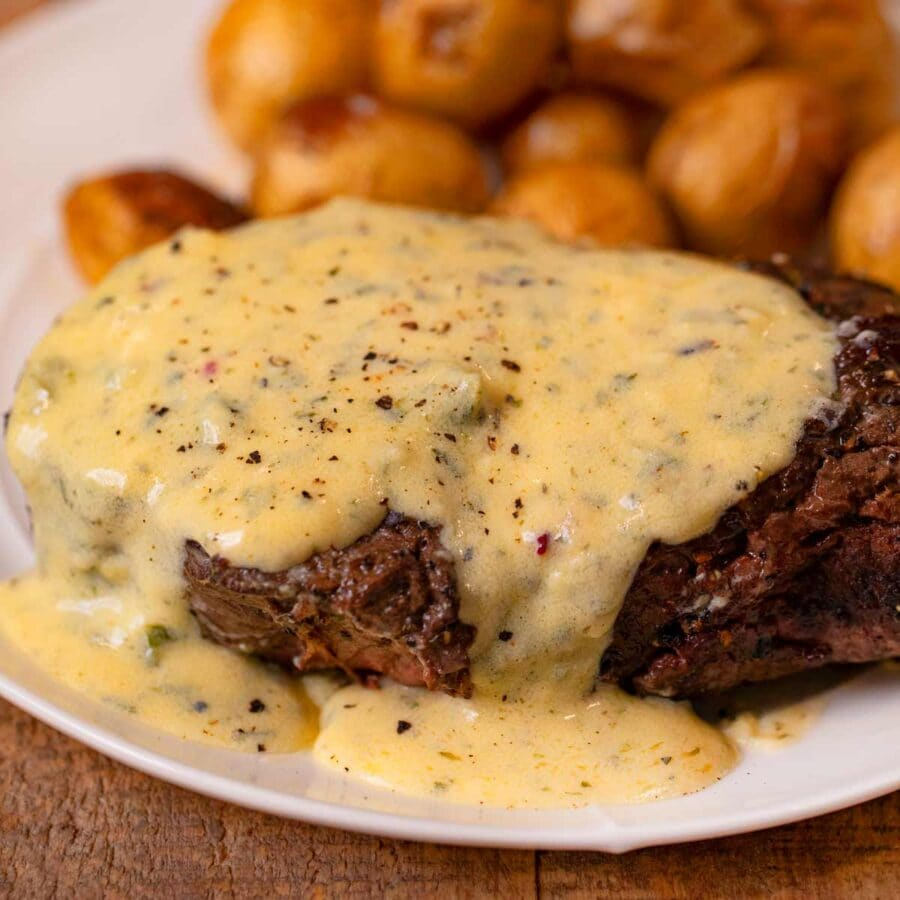 Filet with Bernaise Sauce on plate with roasted potatoes