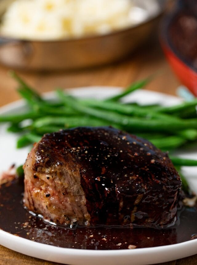 Filet with Red Wine Reduction on plate with green beans