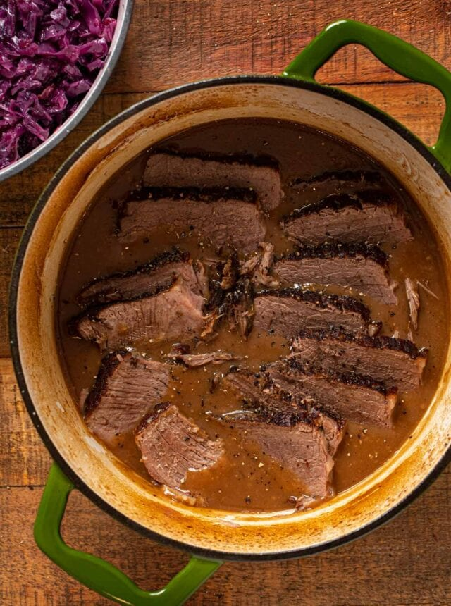 German Sauerbraten in pot, cut into slices