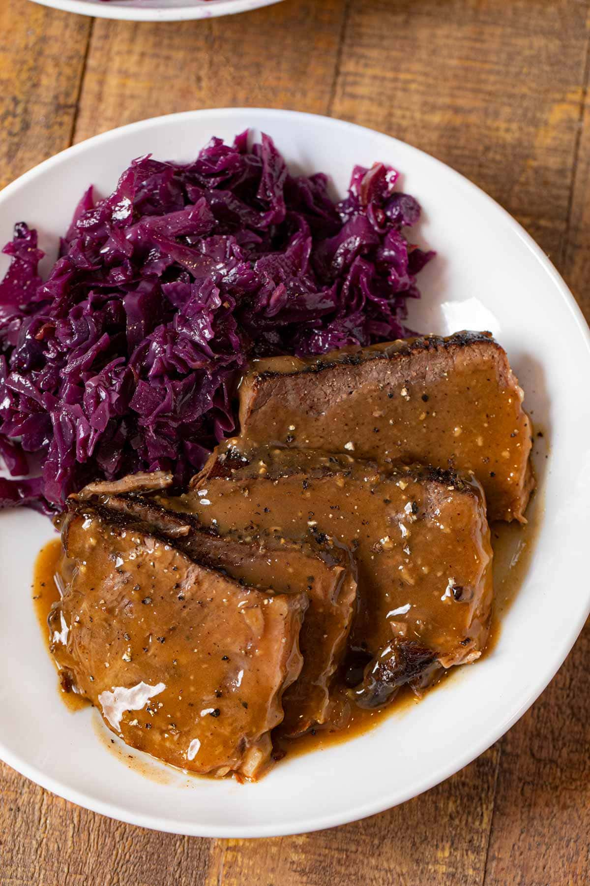 German Sauerbraten on plate with German cabbage