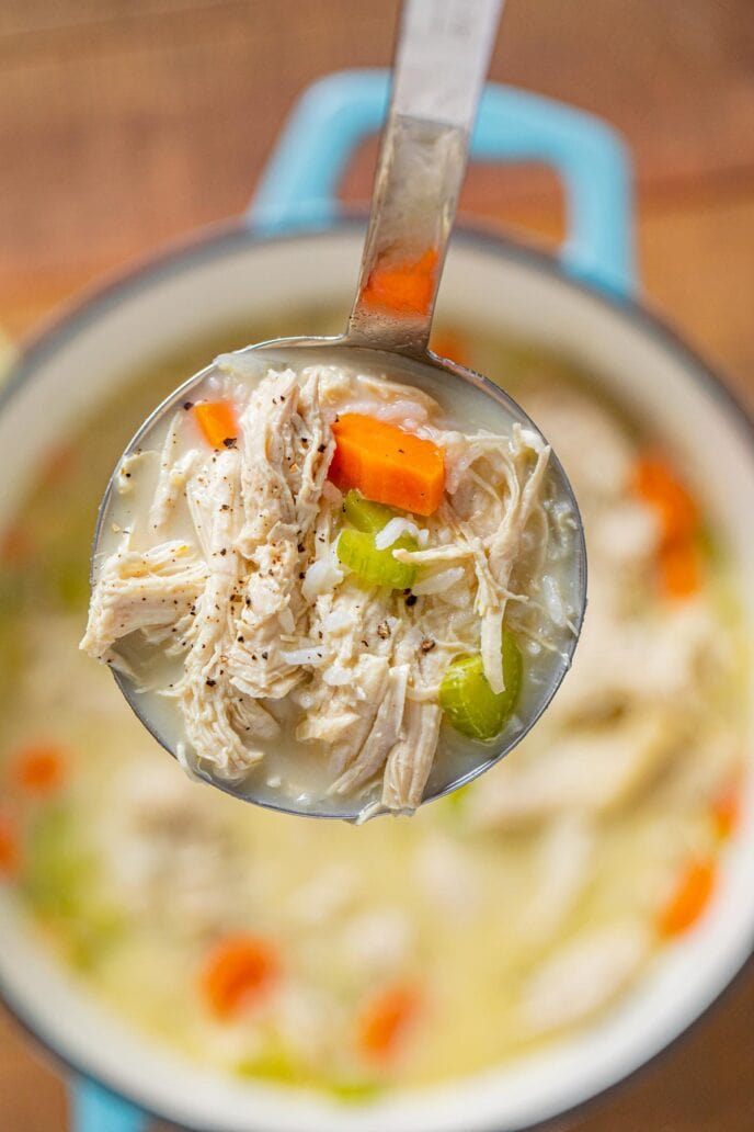 Greek Chicken and Rice Soup (Avgolemono) serving in ladle
