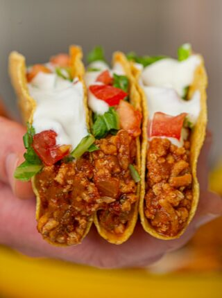 Ground Chicken Tacos three tacos held together