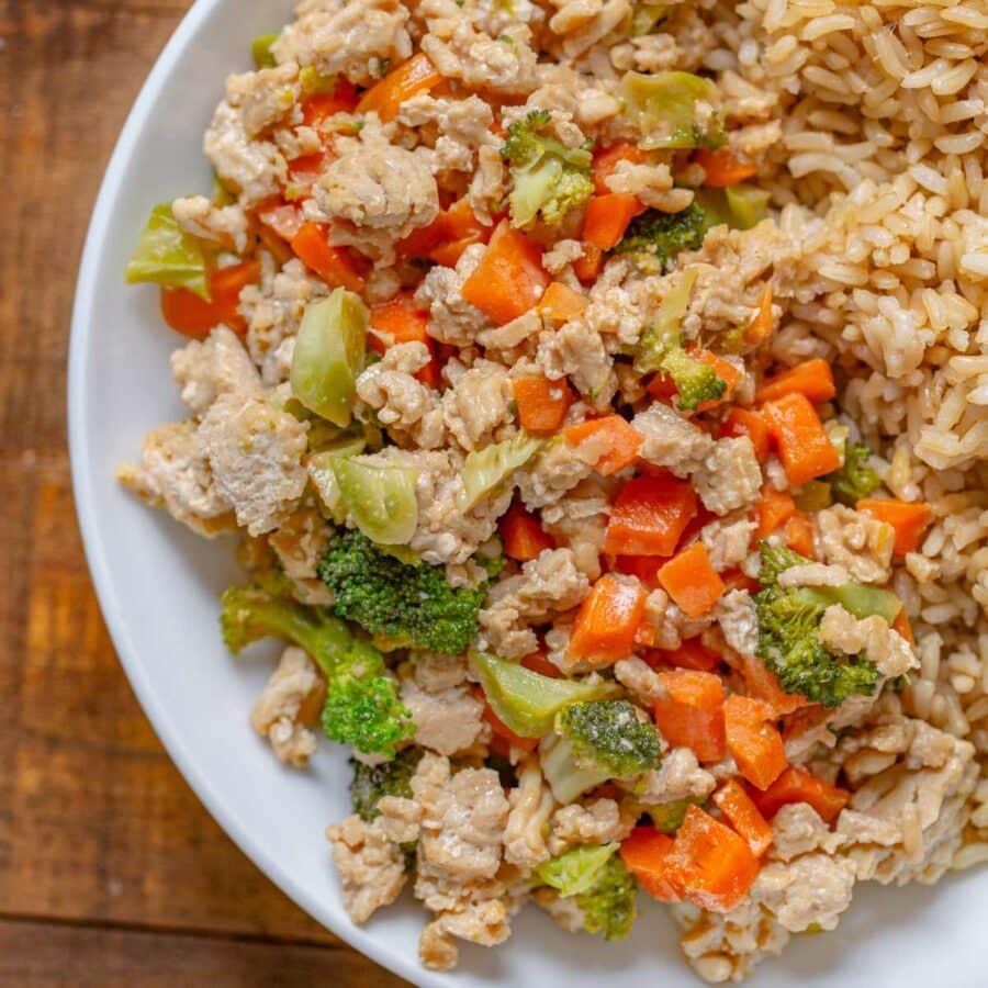 Ground Thai Peanut Chicken on plate with brown rice