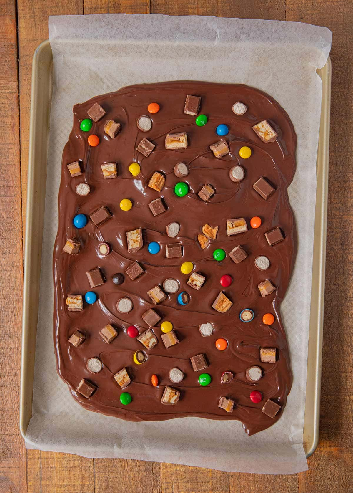 top-down view of Leftover Candy Bar Bark in baking pan
