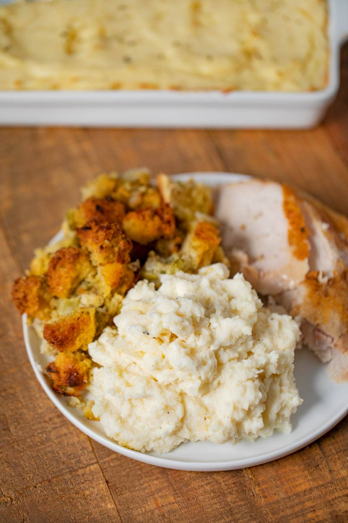 Make-Ahead Mashed Potatoes on plate with turkey and stuffing