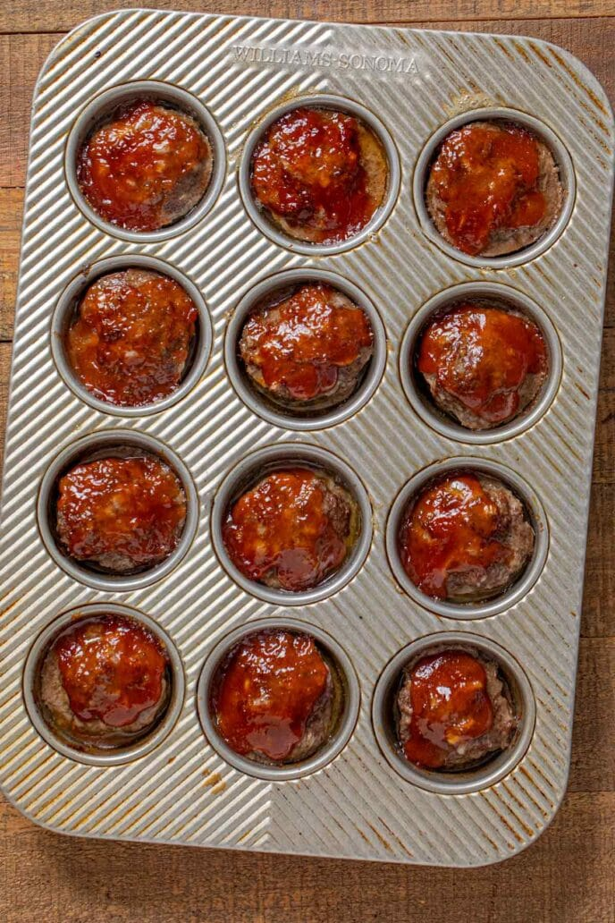 Meatloaf Muffins in muffin tin with ketchup glaze