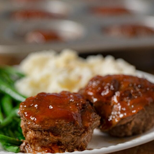 Meatloaf Muffins on plate with mashed potatoes and green beans