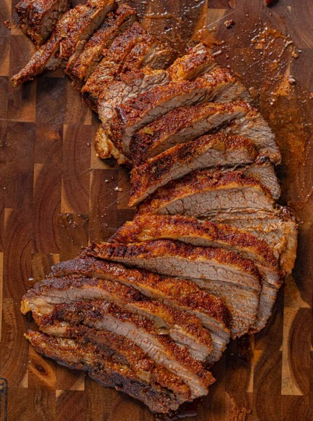 Texas Oven-Roasted Beef Brisket, sliced on cutting board