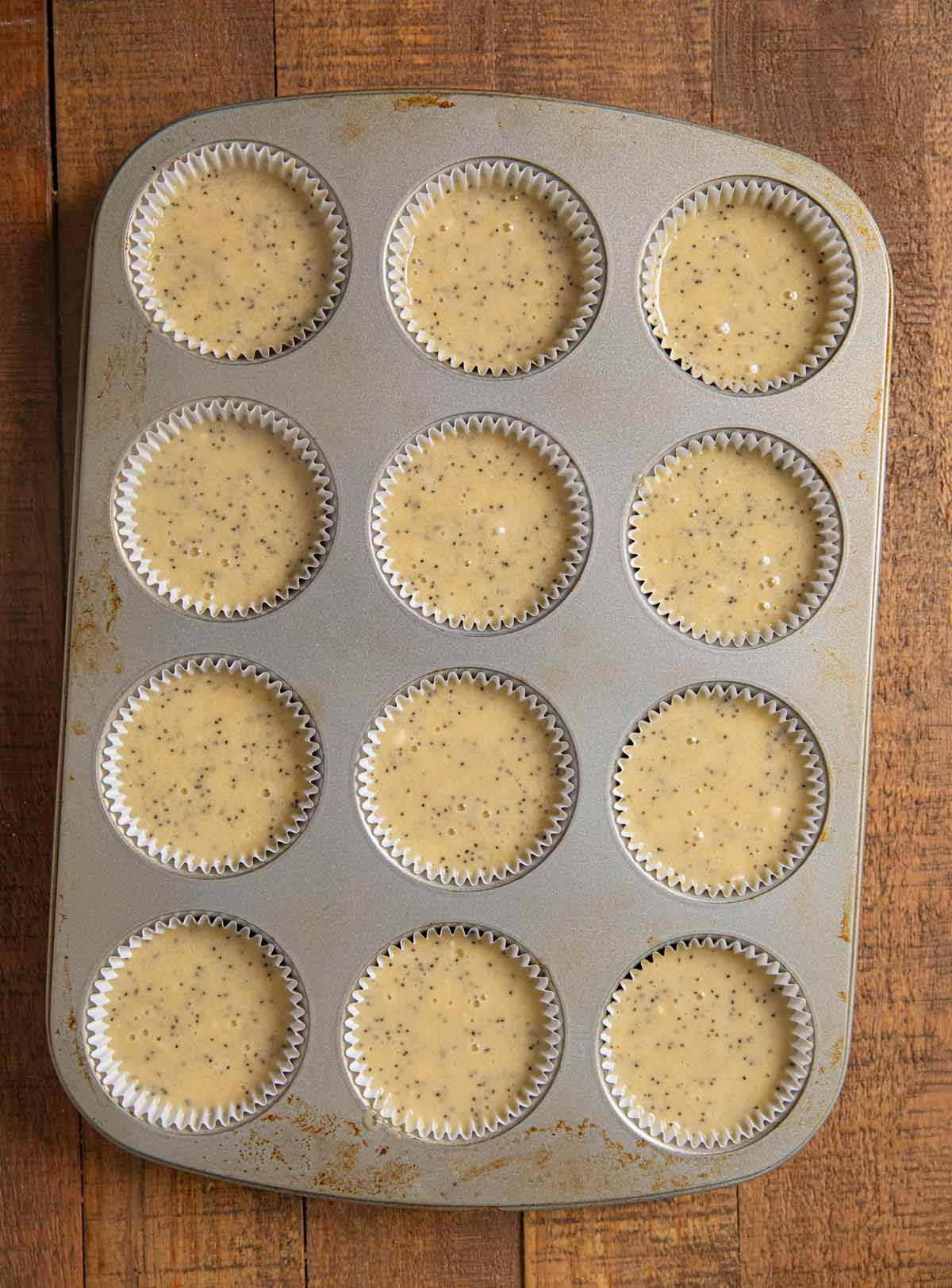 Poppy Seed Muffins in muffin tin before baking