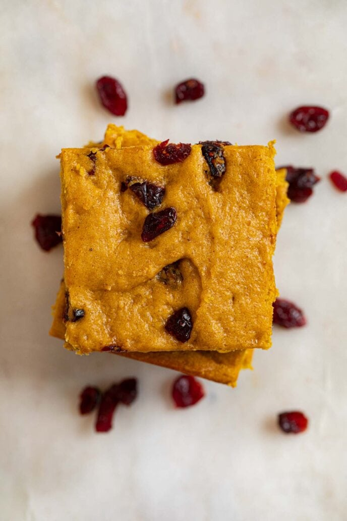 top-down view of Pumpkin Cranberry Bars in stack