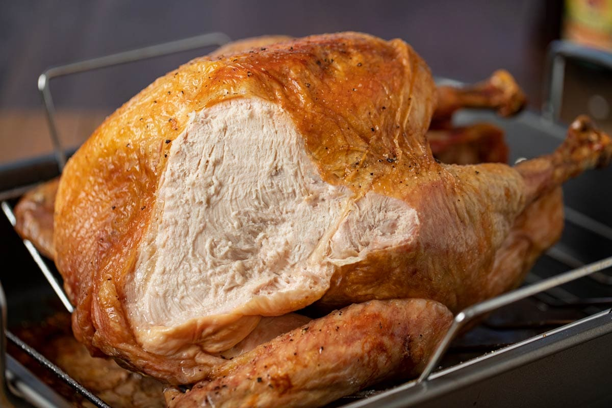 Roast Turkey from Frozen in roasting pan with breast sliced open