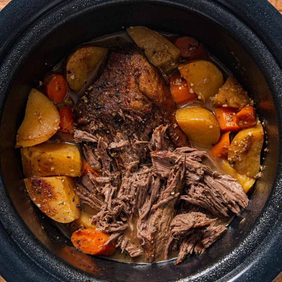 Slow Cooker Rump Roast in crock pot, partially shredded
