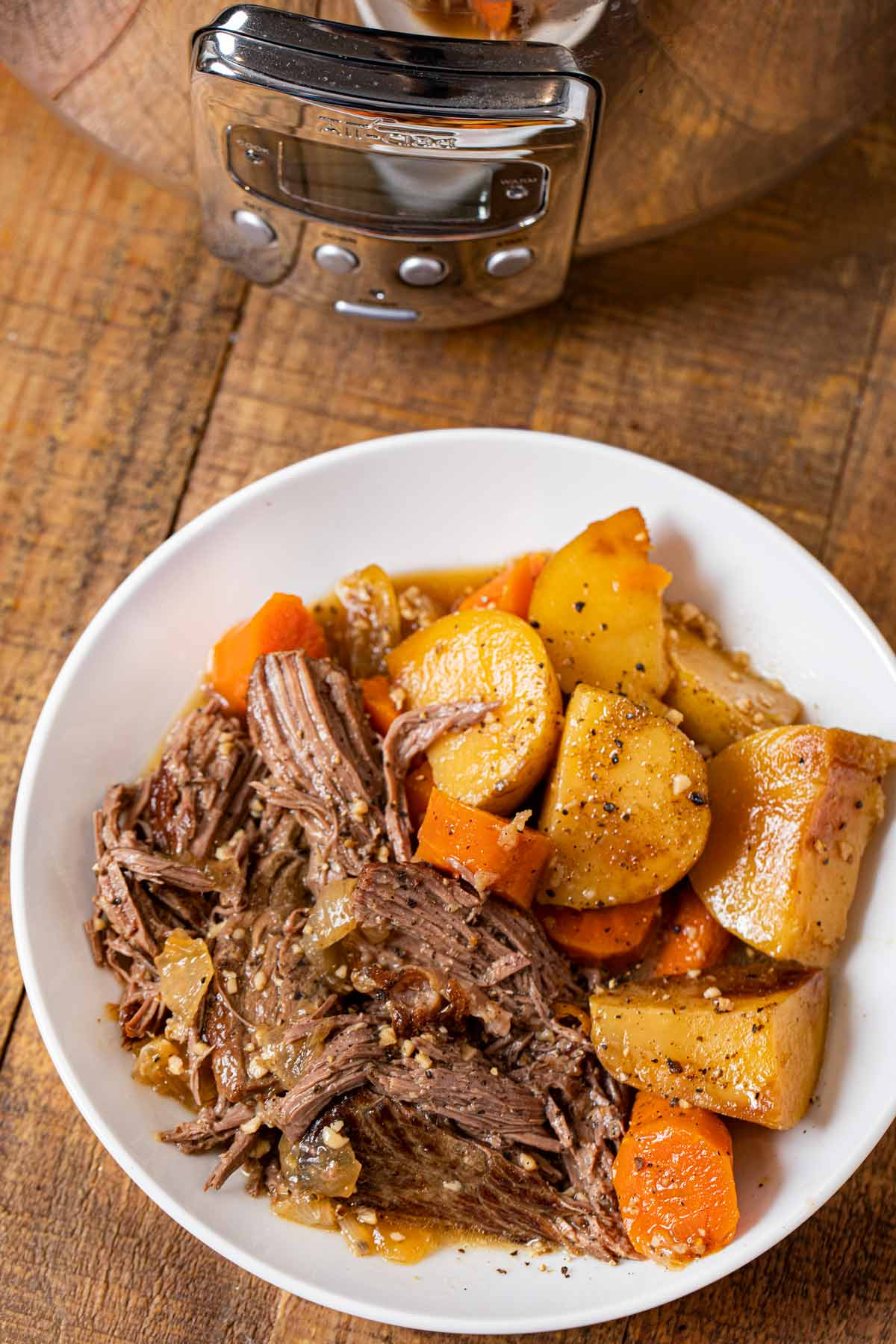 Slow Cooker Rump Roast serving on plate